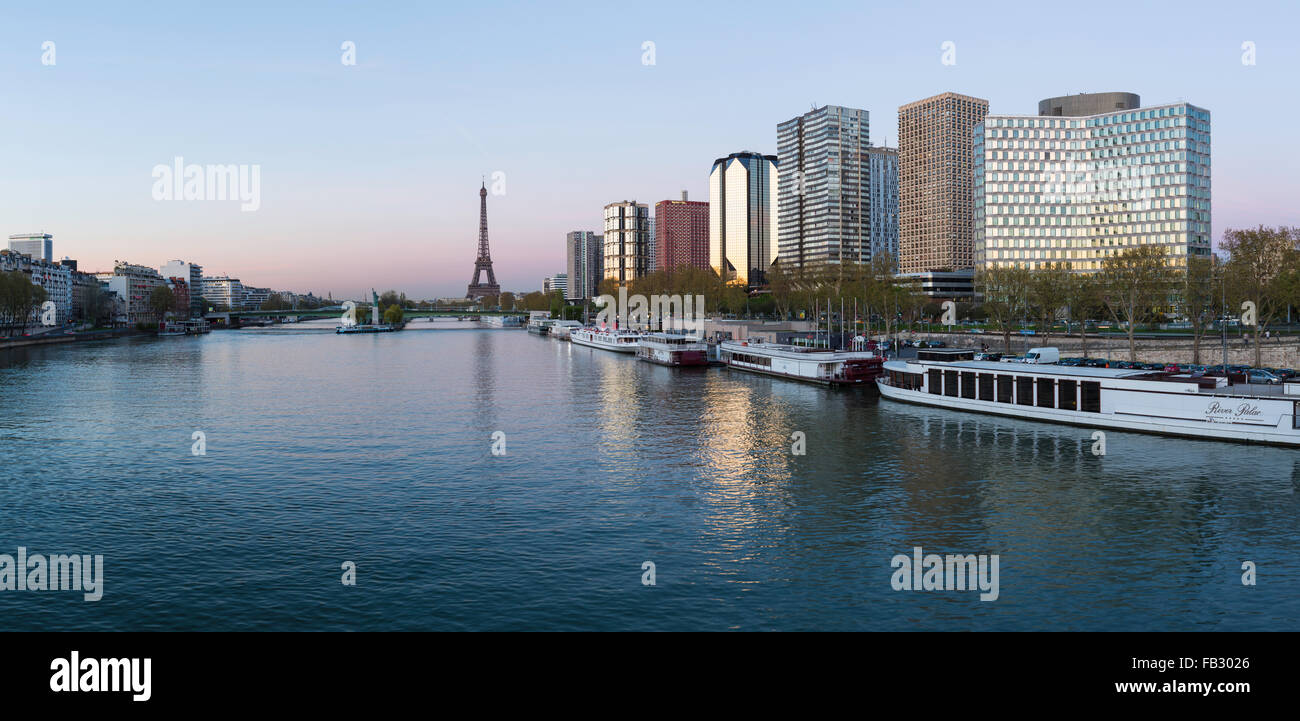 Eiffel Tower and River Seine with boats and high-rise buildings on the Left Bank, Paris, France, Europe - Stock Image