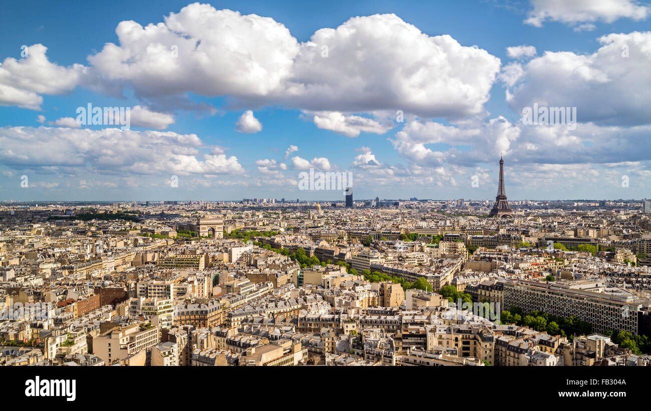 Arc de Triomphe and the Eiffel Tower, elevated city skyline viewed over rooftops, Paris, France, Europe Stock Photo