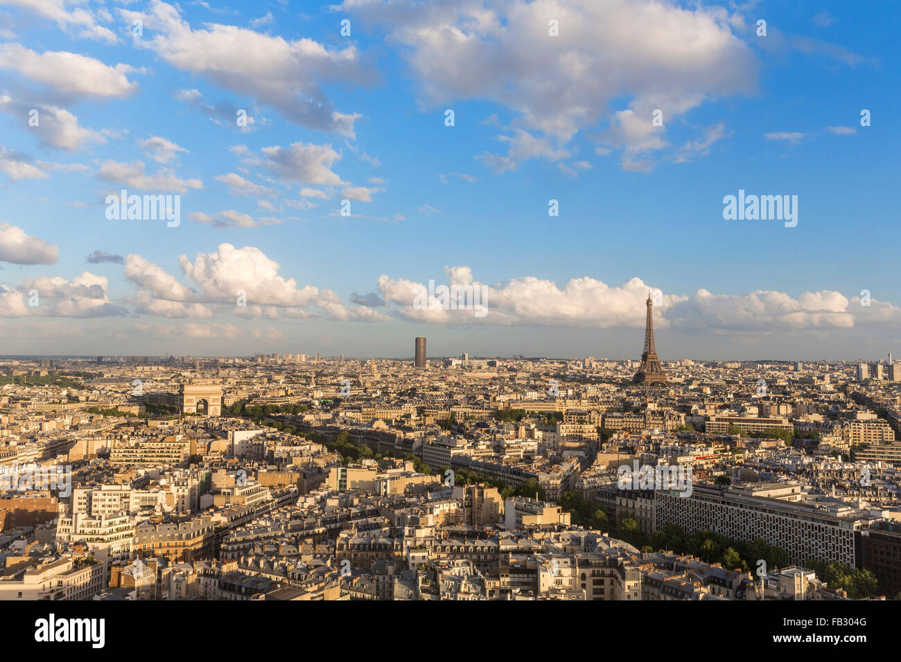 Arc de Triomphe and the Eiffel Tower, elevated city skyline viewed over rooftops, Paris, France, Europe - Stock Image