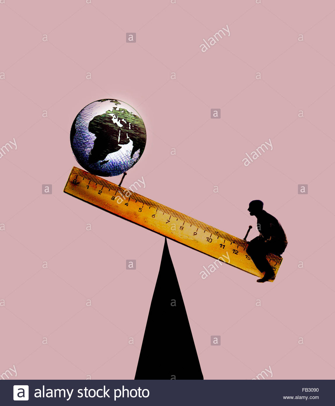 Globe balancing on ruler seesaw with man on opposite end - Stock Image