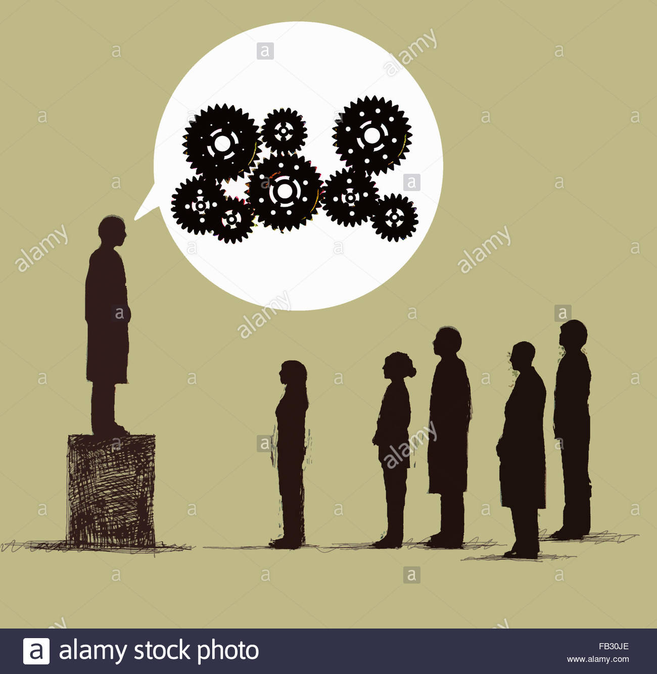 Man on box talking to audience with cogs in speech bubble - Stock Image