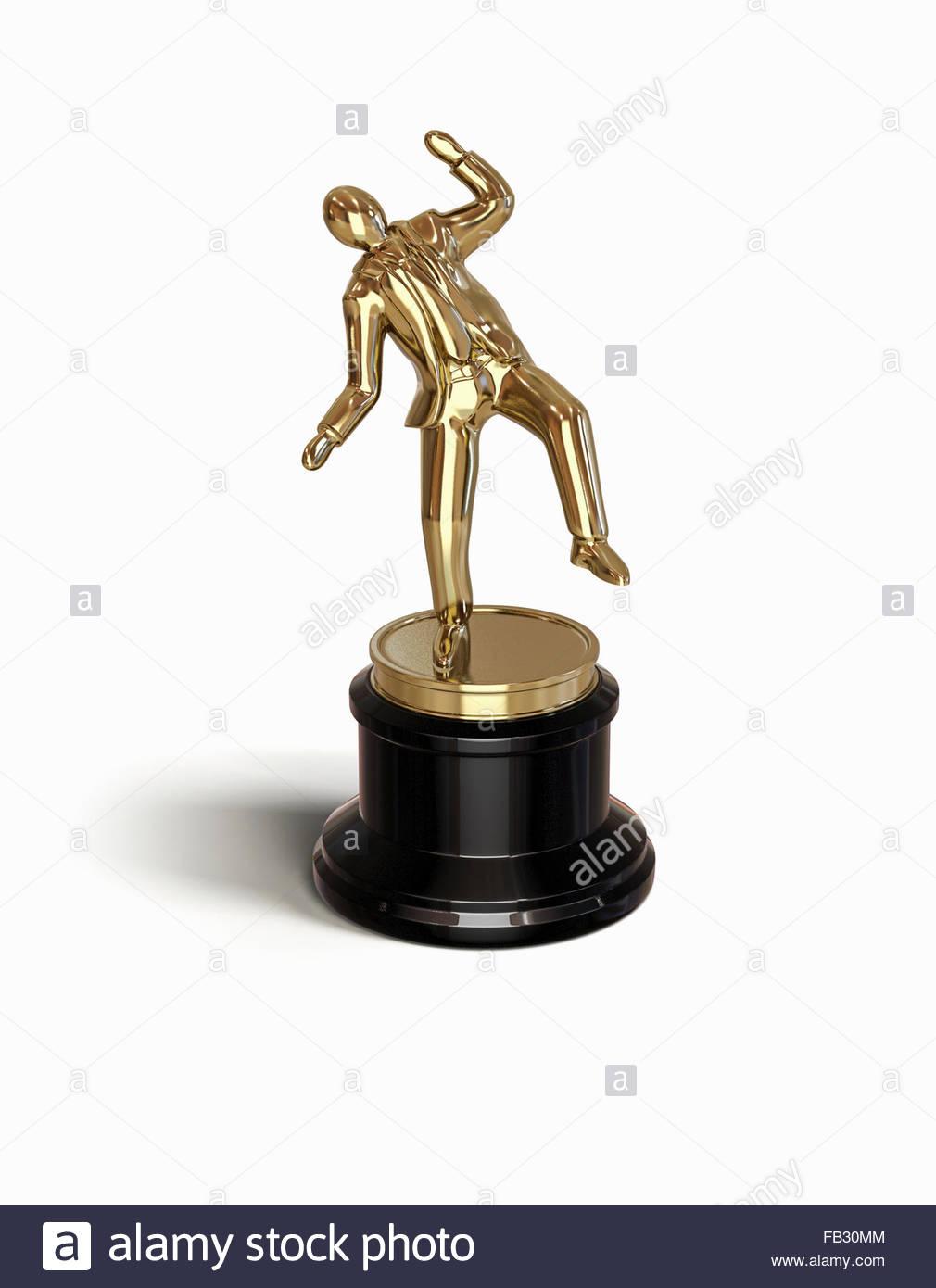 Gold businessman award trophy leaning off balance - Stock Image