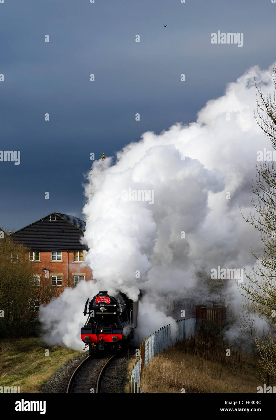 he Flying Scotsman sets off on its first run on the East Lancashire Railway in Bury after 10 years and a £4.2m - Stock Image