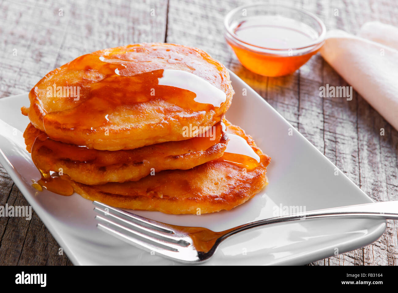 pancakes fritters carrot with maple syrup breakfast - Stock Image