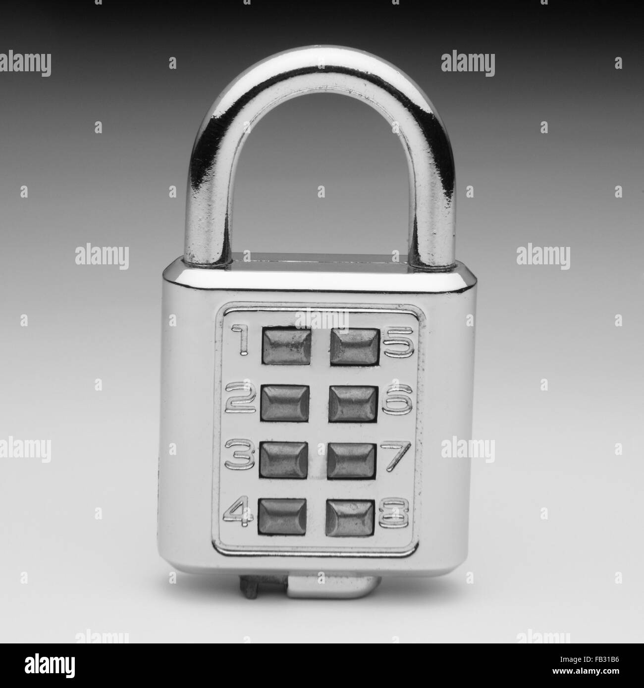 combination lock on the plain color background - Stock Image