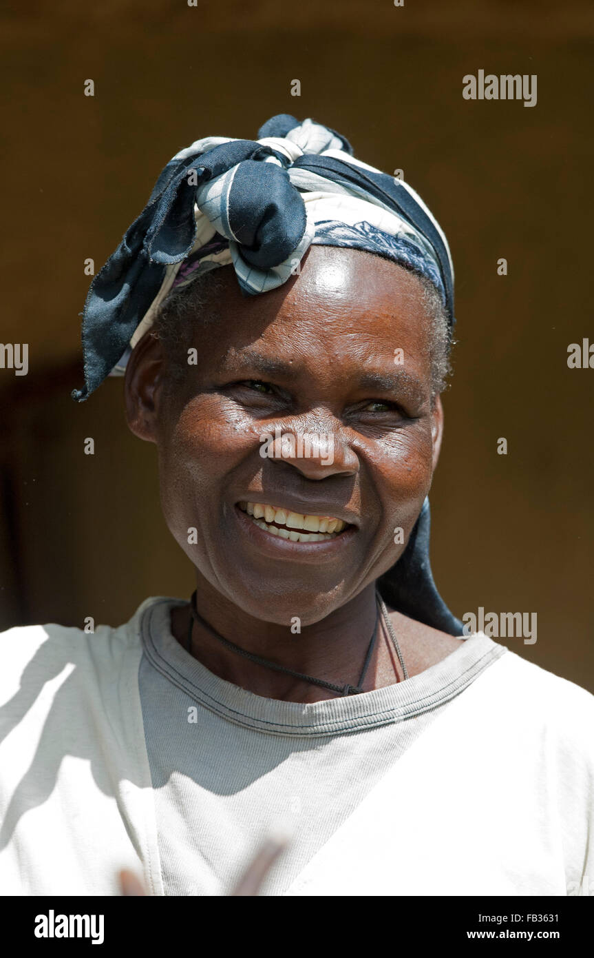 Happy smiling Kenyan woman with a headscarf on. Kenya. Stock Photo