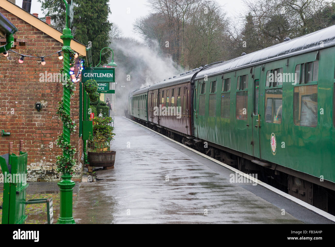 steam train carriages waiting at railway platform - Stock Image
