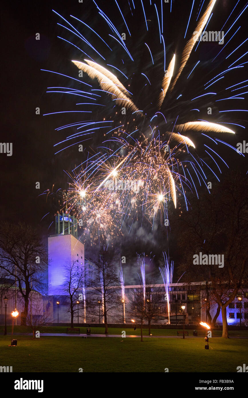 A view of Newcastle Civic Centre in Newcastle upon Tyne at night on New Year Eve with a firework display - Stock Image