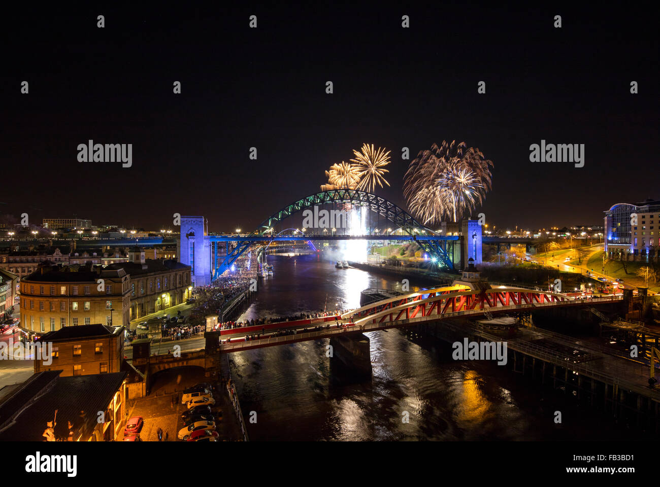 A view of Newcastle and Gateshead quayside at midnight on New Year's Eve with fireworks taken from the High - Stock Image