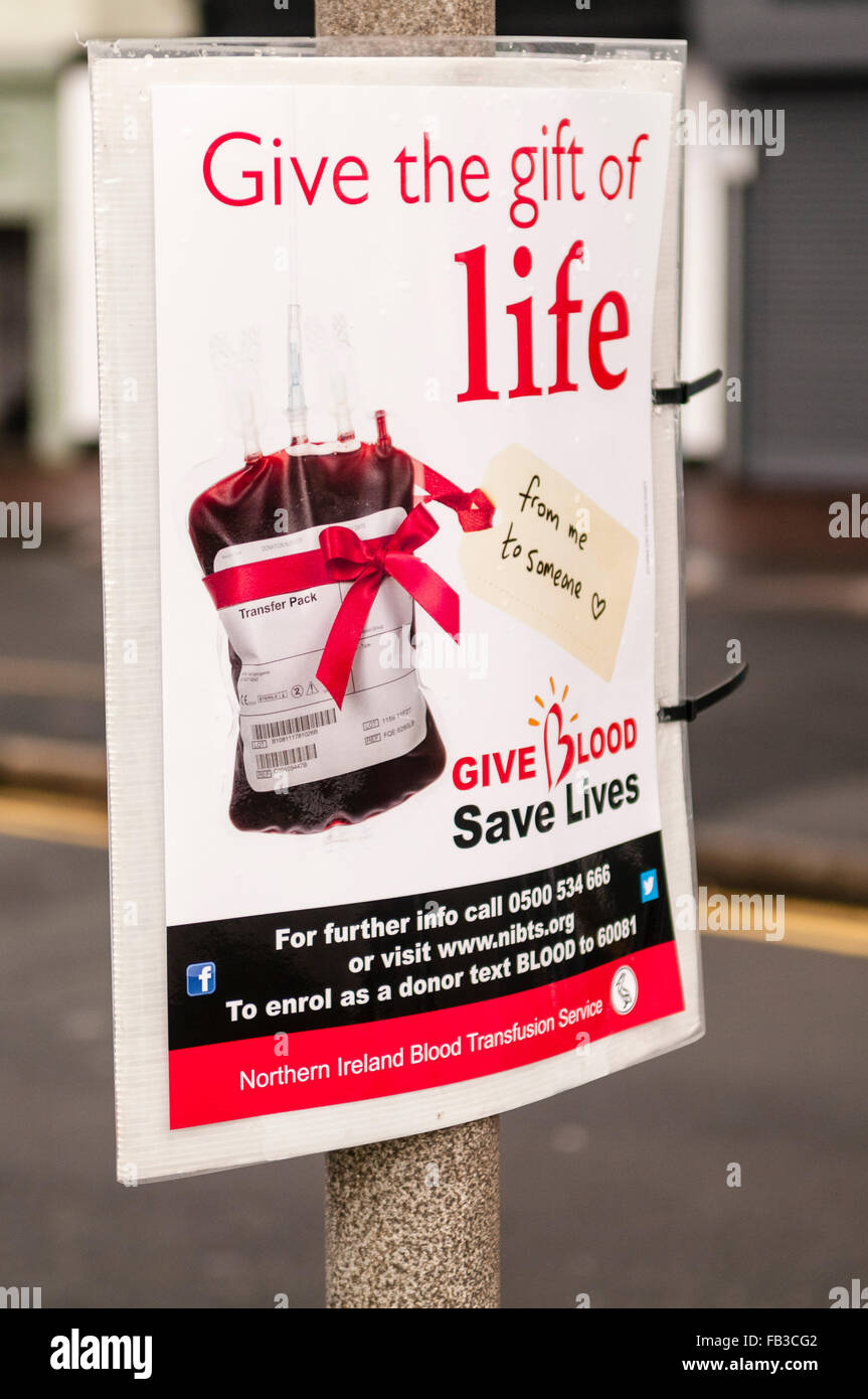 Sign on a lamppost advising the public that blood donation sessions will be taking place. - Stock Image