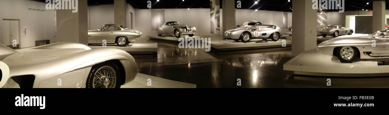 panoramic view of gallery of historic silver cars in Petersens automotive museum in Los Angeles California USA - Stock Image