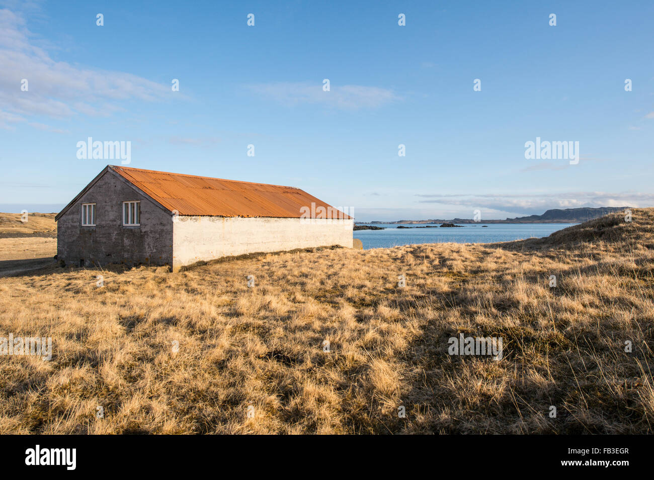 Old Icelandic shelter on a farm near a fjord Stock Photo