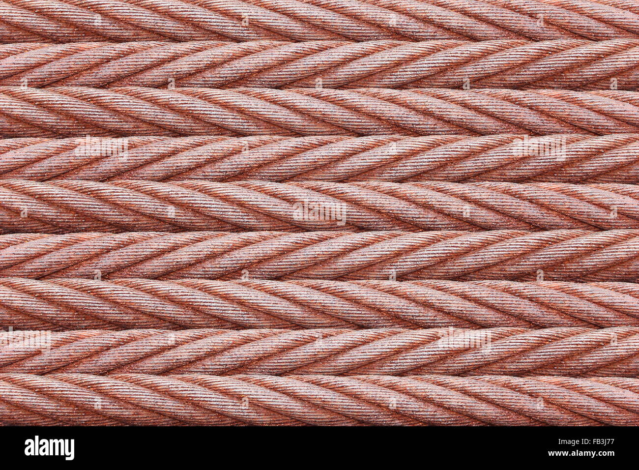 background and texture of many rusty wire rope sling - Stock Image