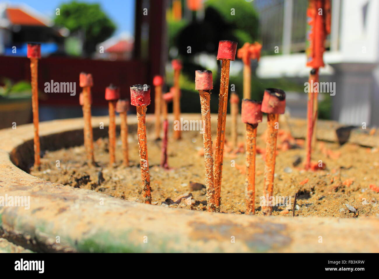 background of extinguish big incense sticks in joss stick pot - Stock Image