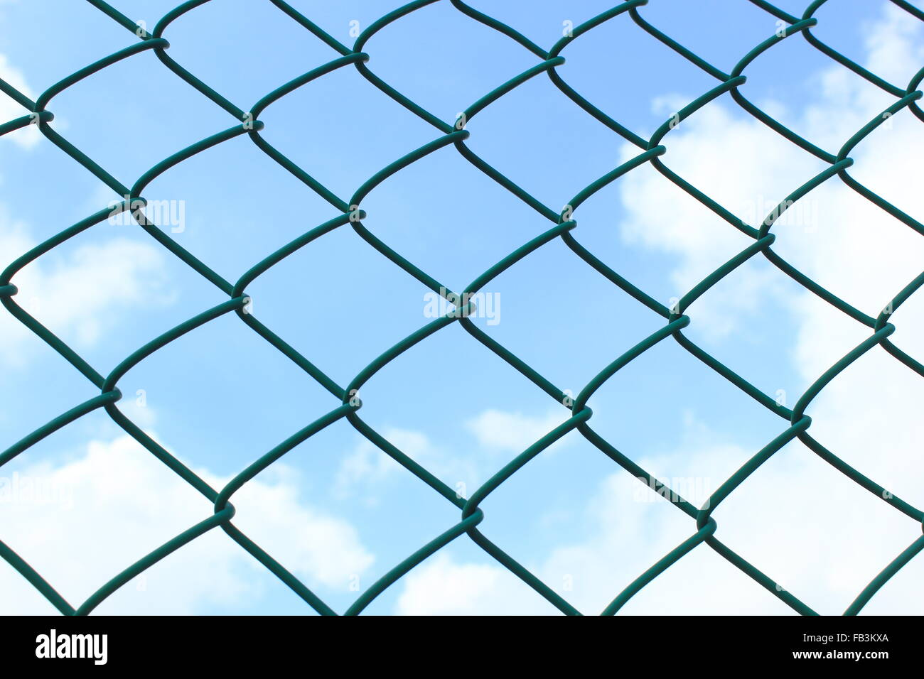 wire fence on sky background during the daytime - Stock Image