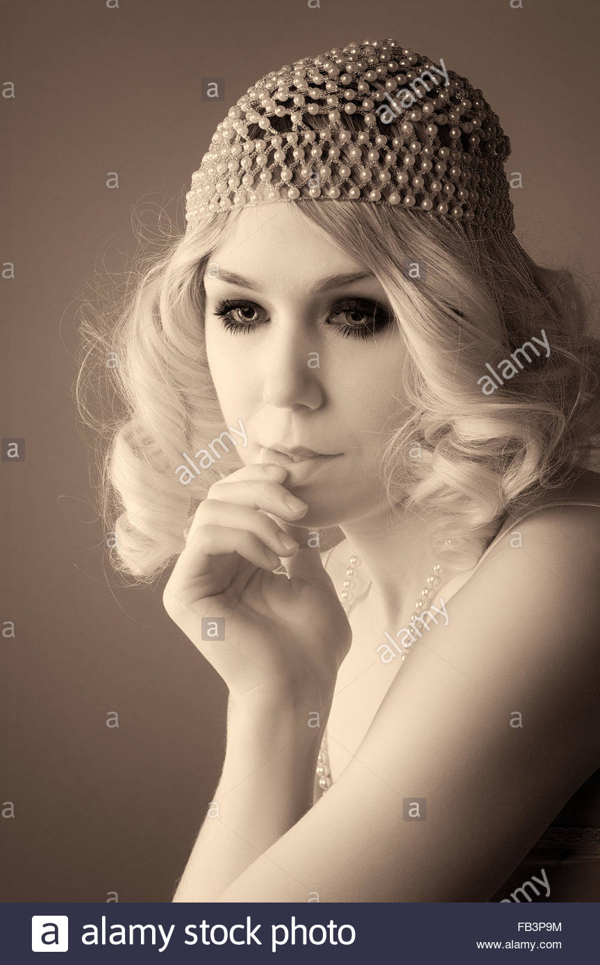 Woman Dressed In A 1920 S Style Flapper Beaded Cap With