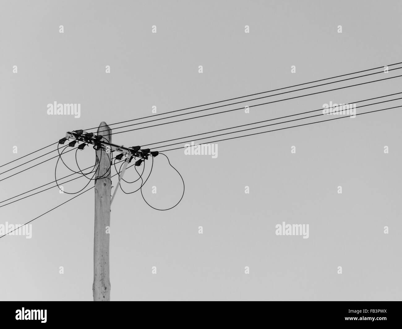 view of the head of an old-fashioned electric pole with wires and ...