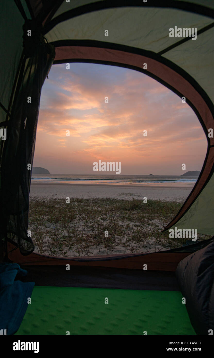 Sunrise on empty Tai Long Wan (Big Wave Bay) beach, Sai Kung, Hong Kong - Stock Image