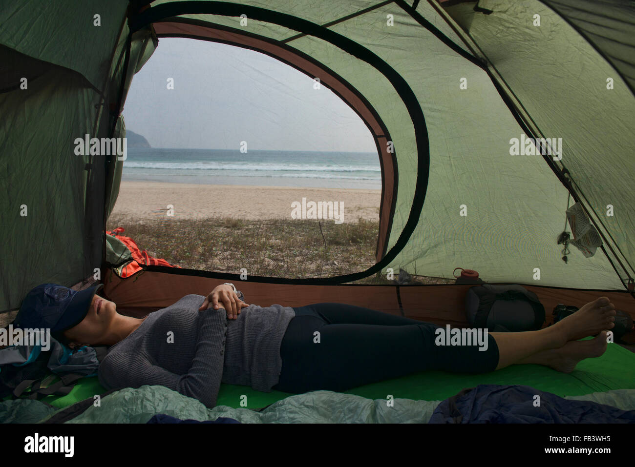 Camping on empty Tai Long Wan (Big Wave Bay) beach, Sai Kung, Hong Kong - Stock Image