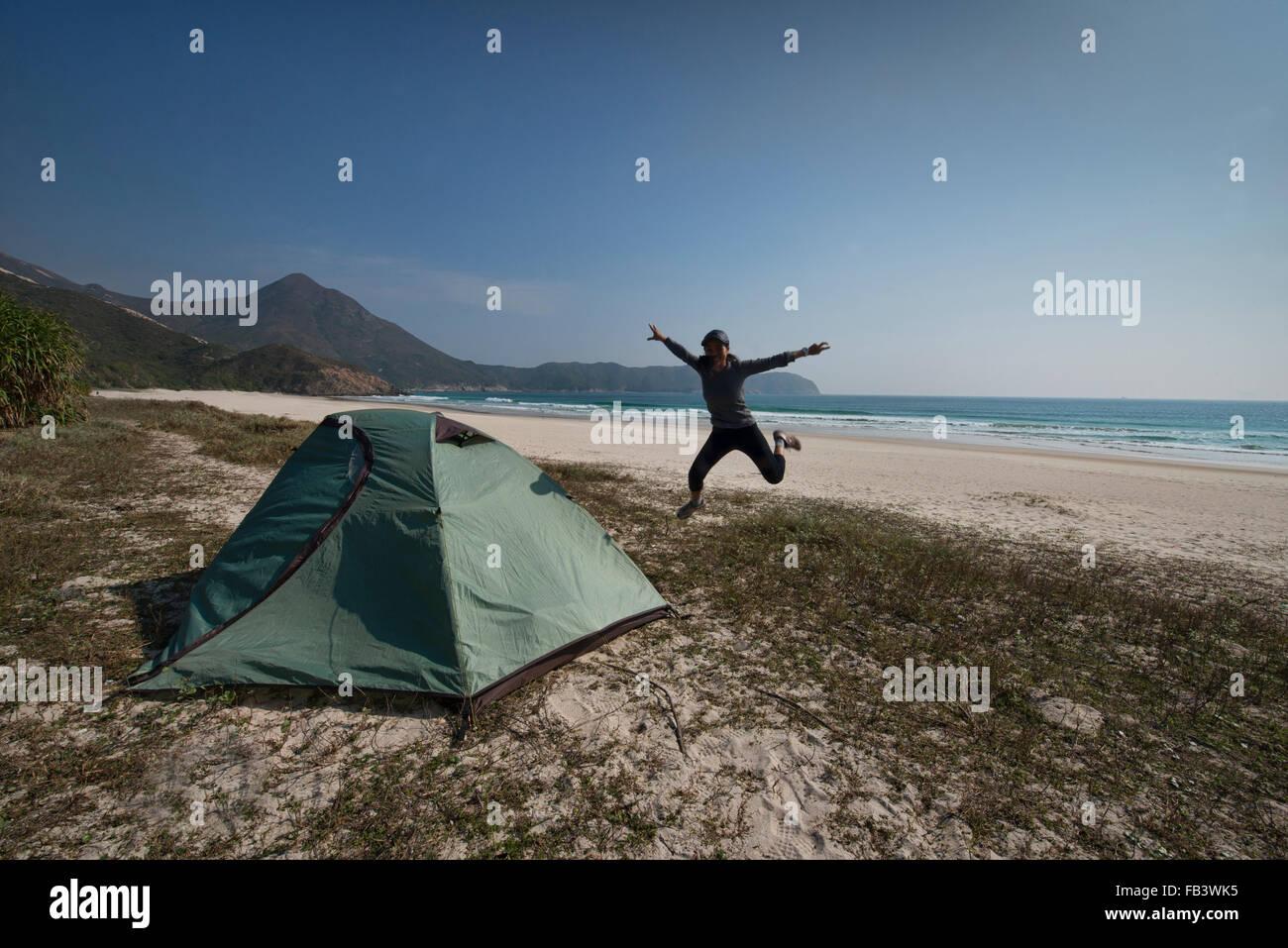 Camping on empty Tai Long Wan (Big Wave Bay) beach, Sai Kung, Hong Kong - Stock Image