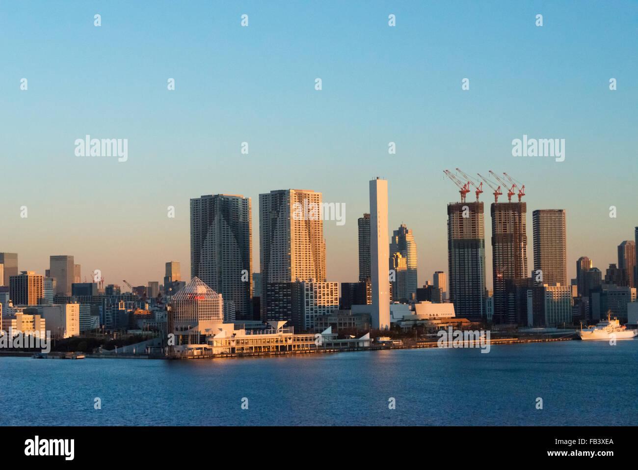 High rises along the waterfront in Tokyo Harbor at dawn, Tokyo, Japan Stock Photo