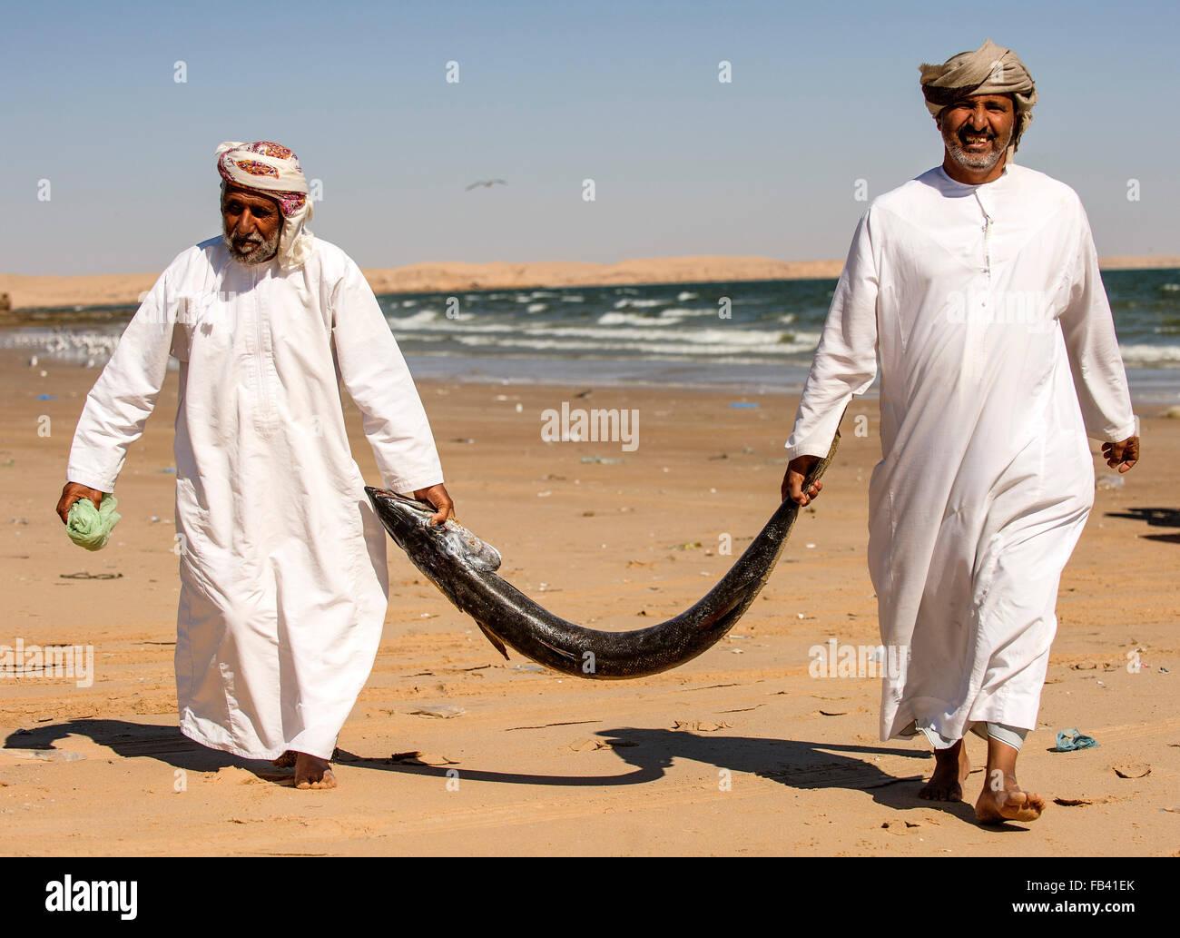 Fishermen and barracuda, Oman - Stock Image