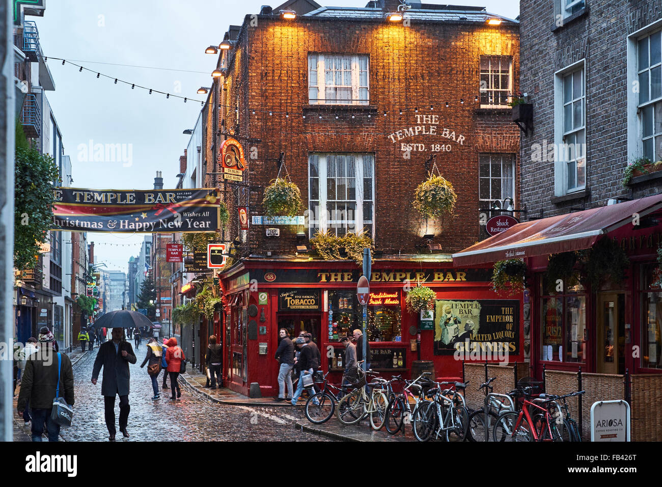 DUBLIN, IRELAND - JANUARY 05: Street in Temple Bar during rainy evening. The area is the heart of tourism in the - Stock Image