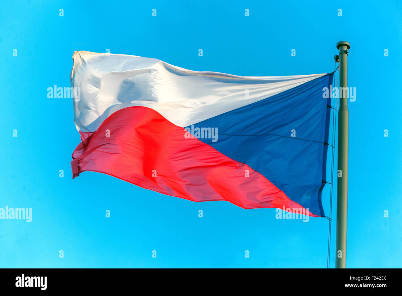 Czech flag blowing in the wind on a flagpole, Czech Republic - Stock Image