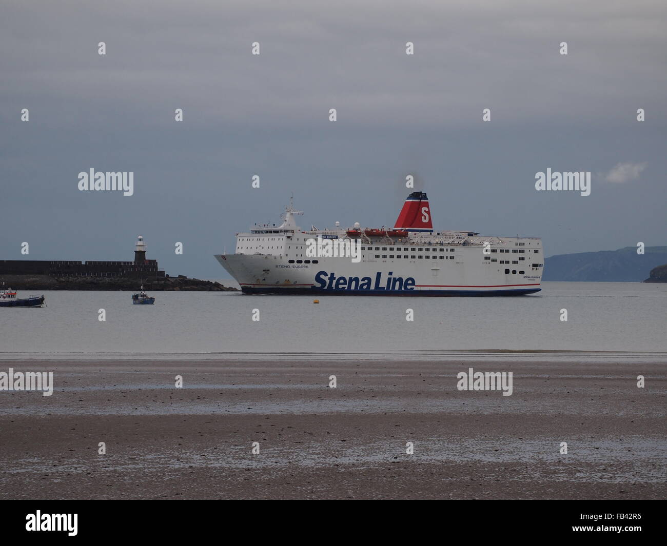 Stena Line ferry entering Fishguard harbour in Wales - Stock Image