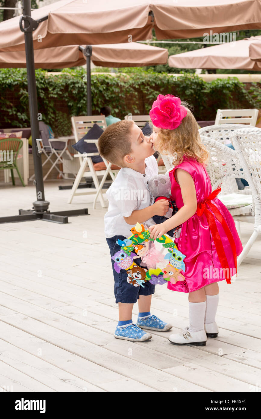 The Boy Kid Gives Flowers And Kissing Girl Child On Birthday Little Adorable Celebrating 3 Years Childhood