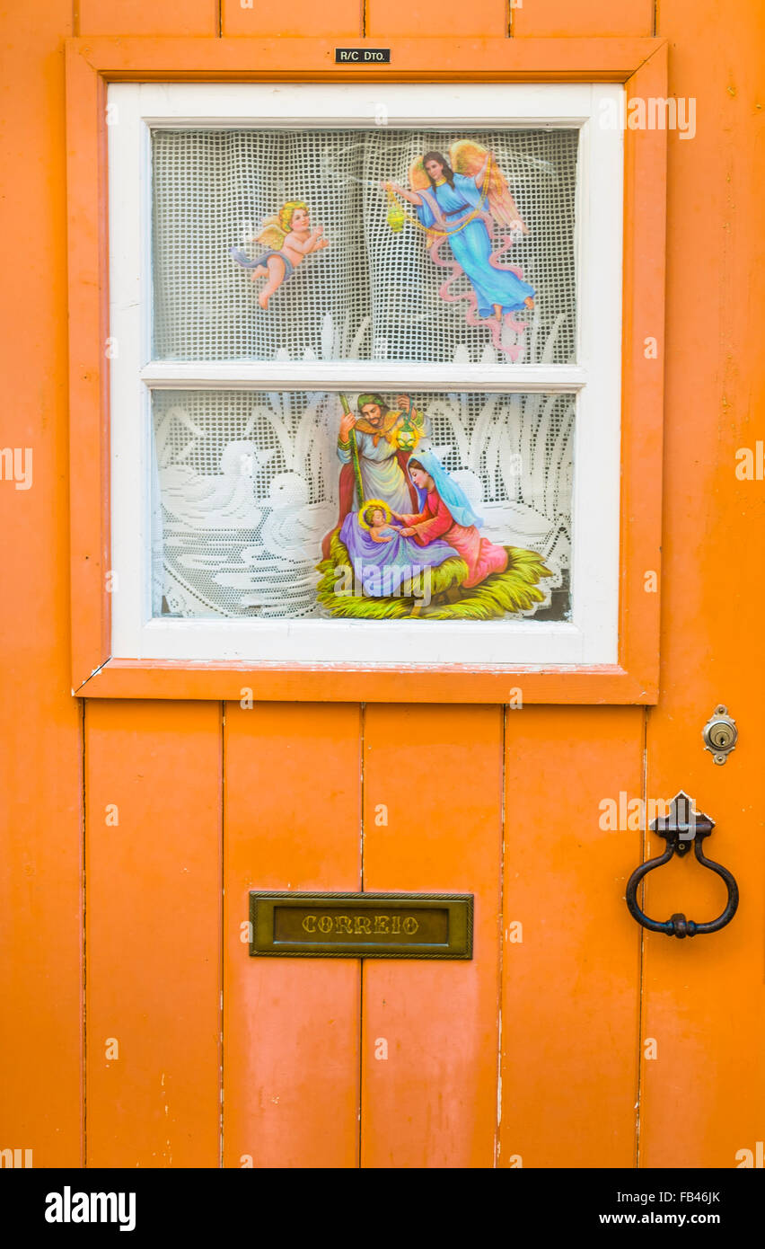 christmas decoration on a door in the alfama district, lisbon, portugal - Stock Image