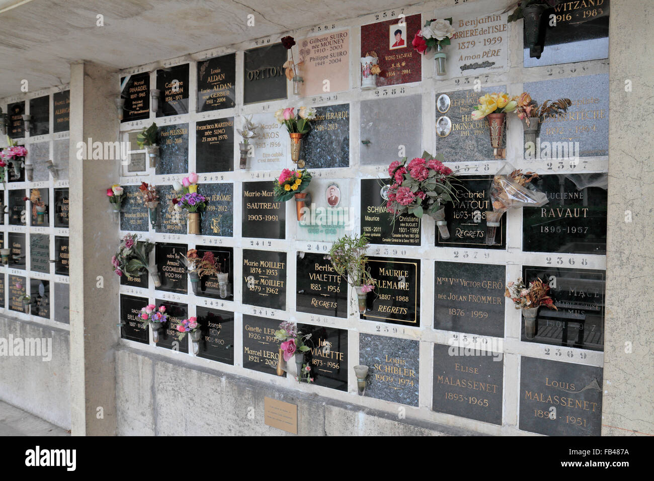 Nameplates over the cinerary urns Columbarium in the Père Lachaise Cemetery, Paris, France. - Stock Image