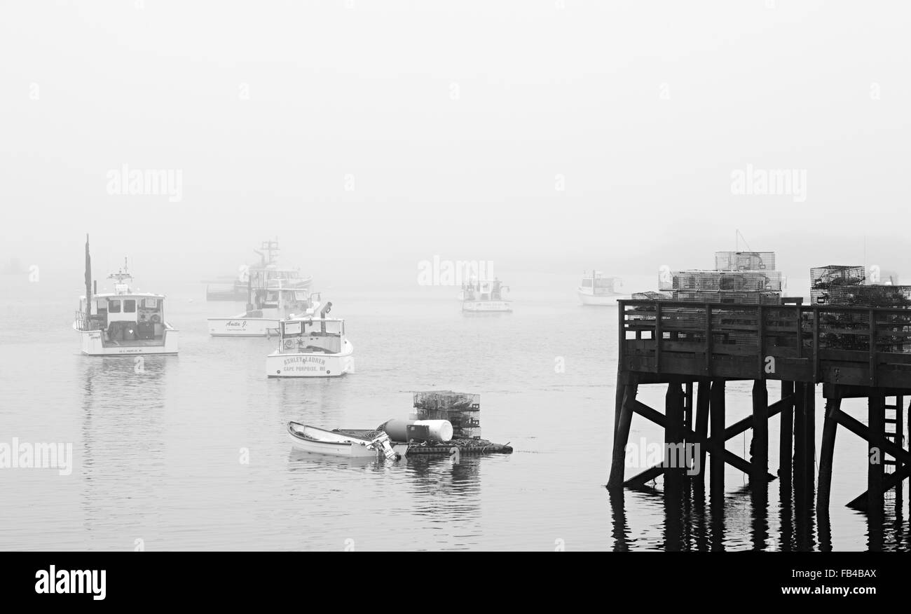Dock and lobster boats in fog, Cape Porpoise, Kennebunkport, York County, Maine - Stock Image