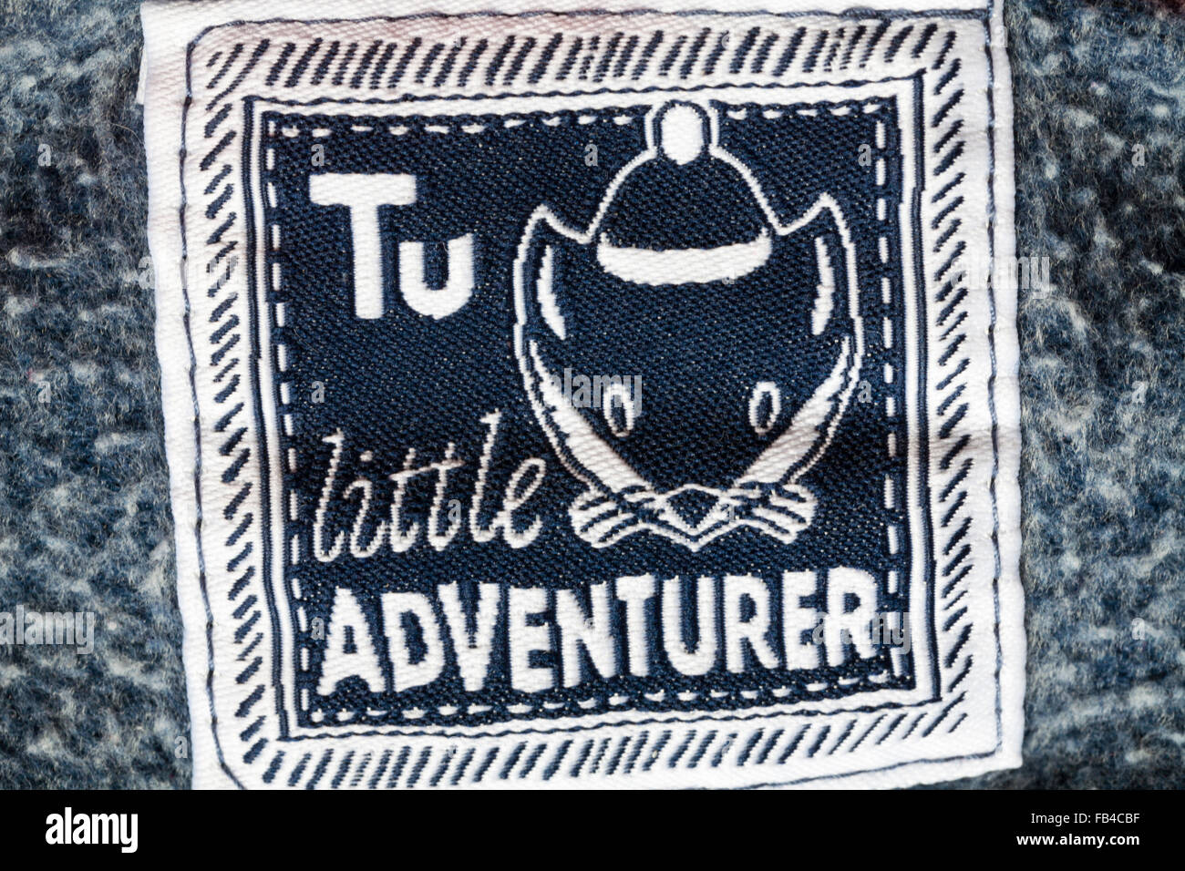 TU little adventurer label in toddlers clothing - Stock Image