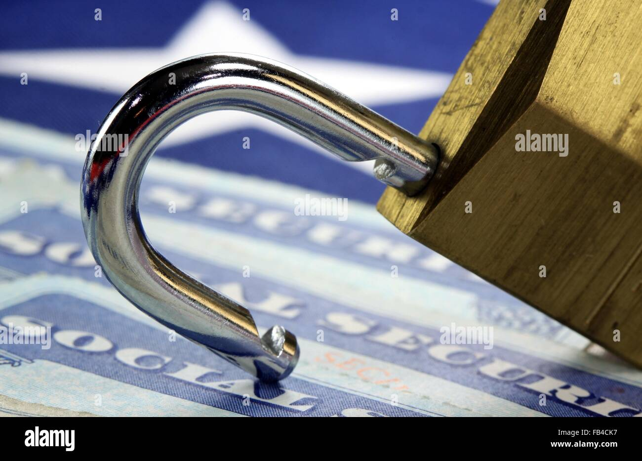 Padlock and social security card - Identity theft and identity protection concept - Stock Image