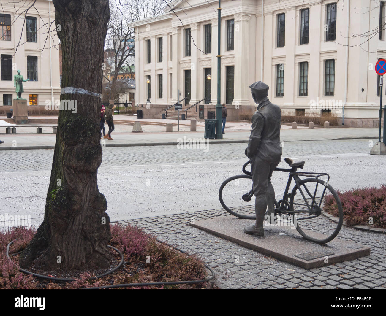Sculpture of the Norwegian war hero Gunnar Sønsteby with bike in Karl Johans gate Oslo Norway, fought in WWII, - Stock Image