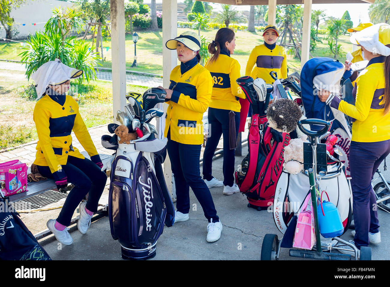 Ayuthaya, Thailand - December 27, 2015 : Caddie girls waiting for tee off time - Stock Image