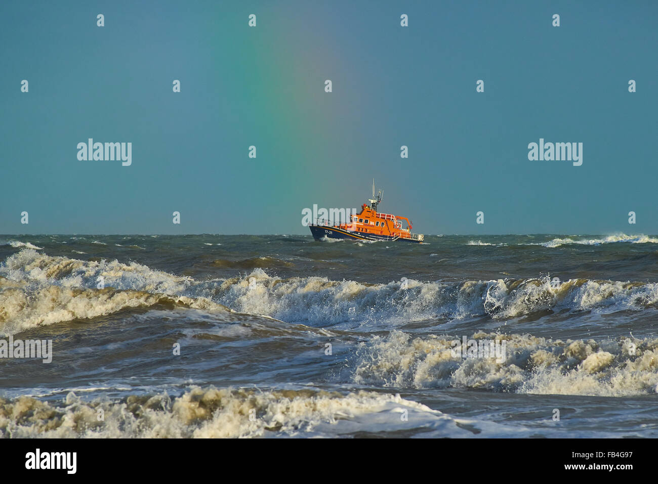 Lifeboat at Sea under a rainbow - Stock Image