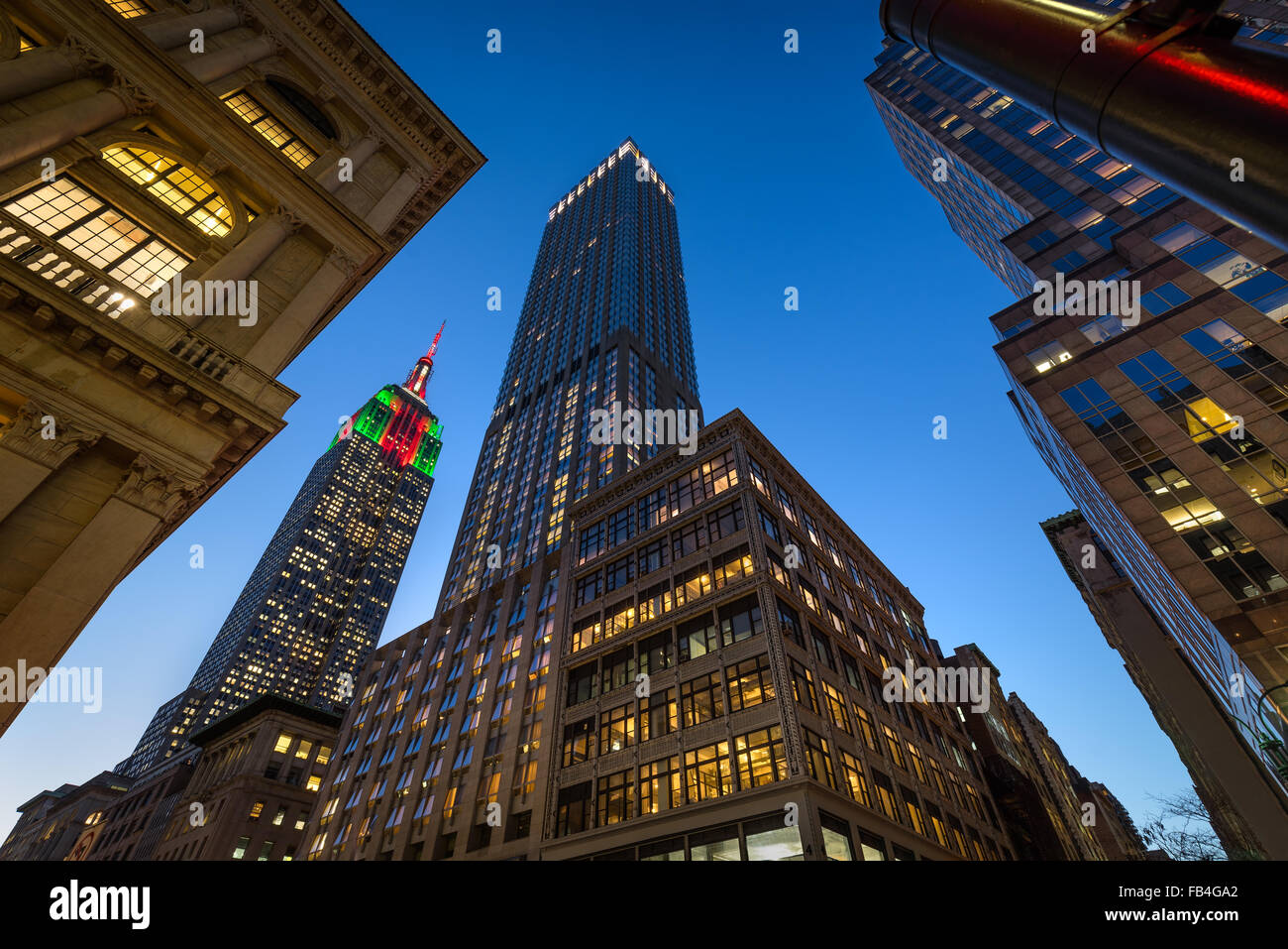 The Empire State Building illuminated with Christmas lights at twilight. Skyscrapers on 5th Avenue, Midtown Manhattan, - Stock Image