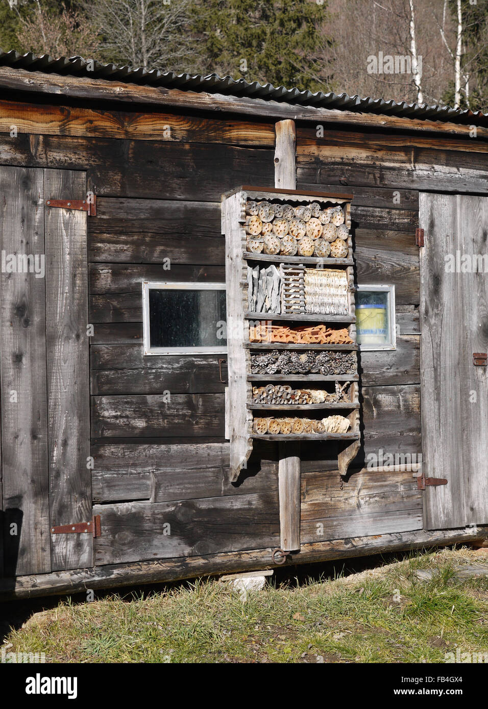 Example of an insect house made by a local artisan Bois in Le Crot, Vallorcines in France - Stock Image