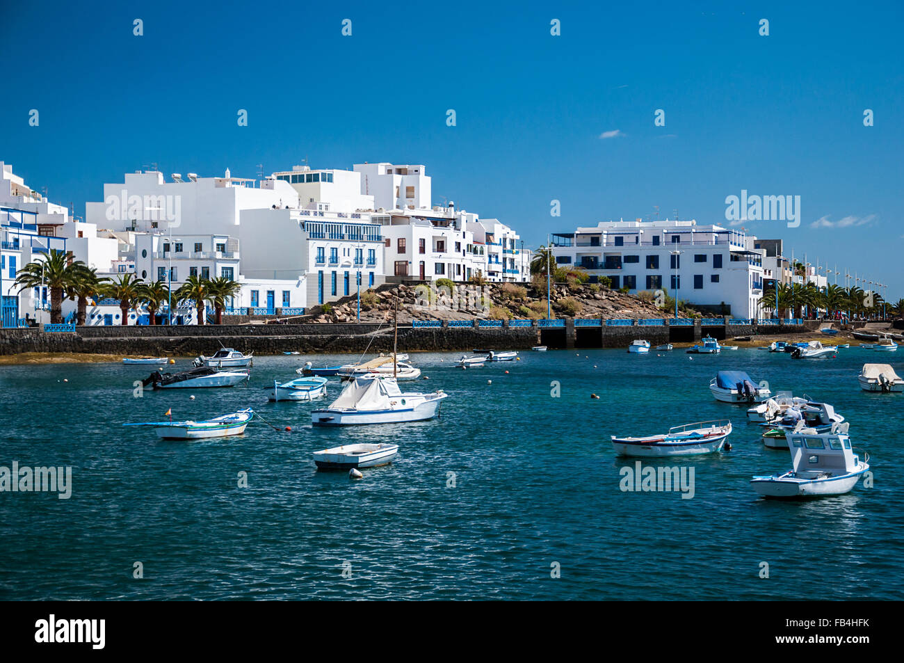 Fisher boats at the laguna Charco de San Gines, city of Arrecife, Lanzarote, Canary Islands. - Stock Image