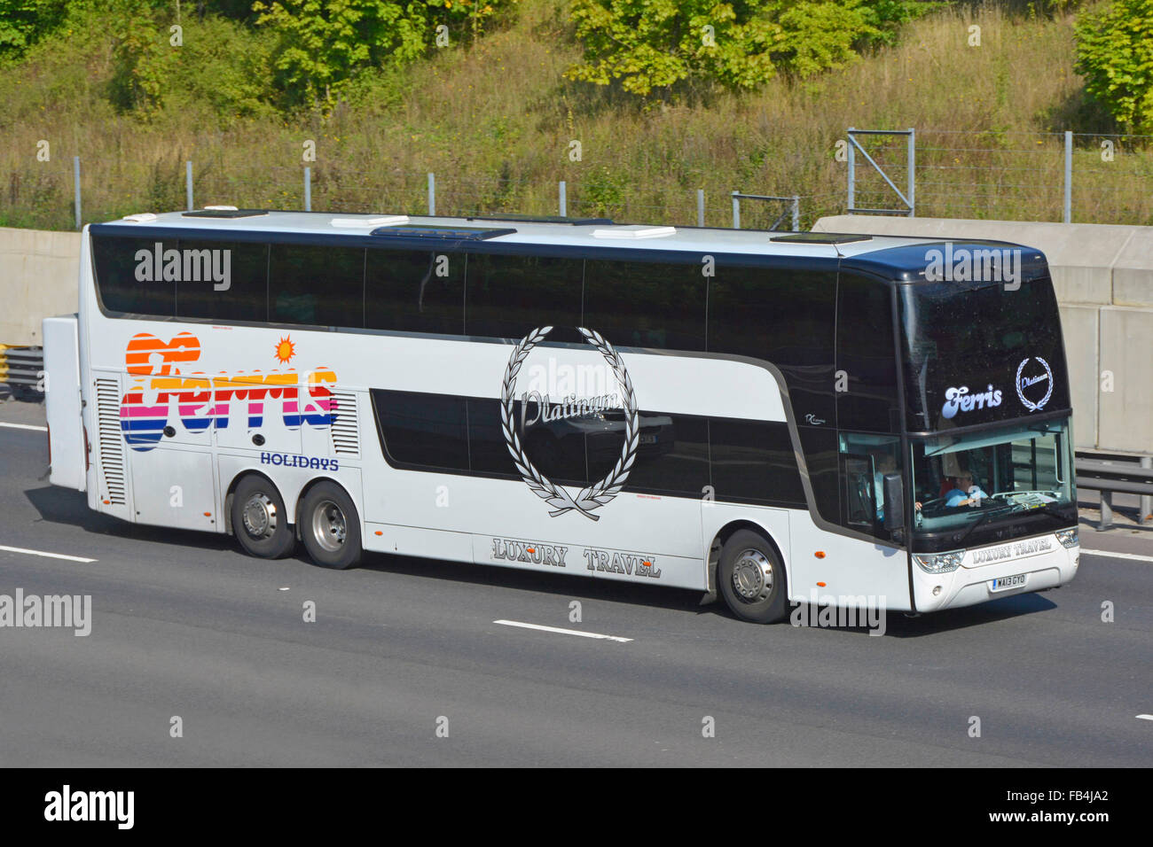 Ferris Holidays Luxury Travel double decker coach driving along motorway - Stock Image