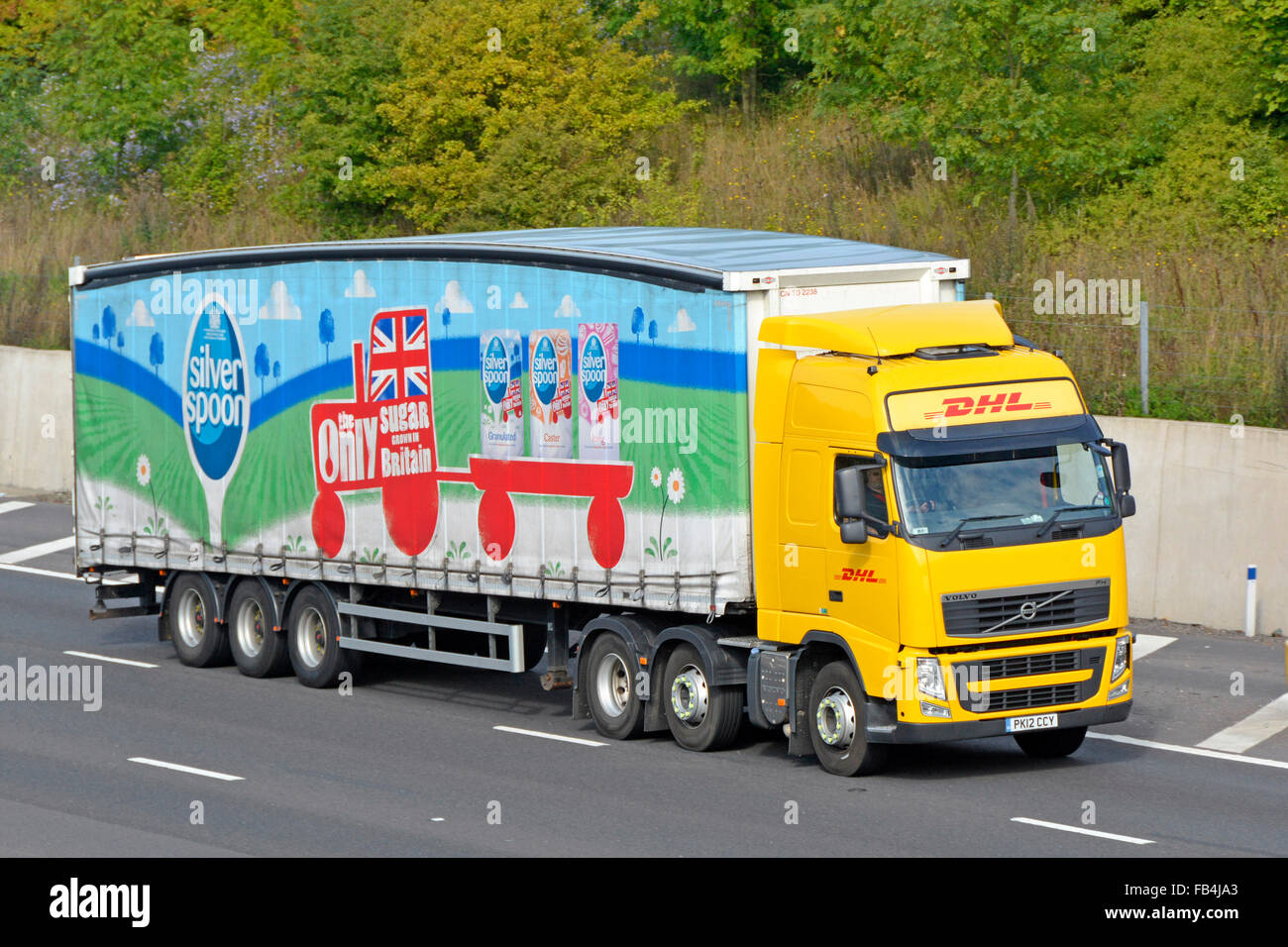 DHL Volvo lorry truck & soft sided articulated curtain trailer advertising Associated British Foods 'Silver - Stock Image