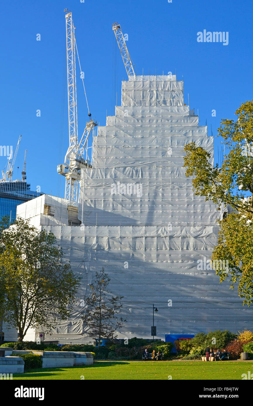 10 Trinity Square Tower Hill hidden by plastic cocoon during refurbishment conversion into split use hotel & - Stock Image