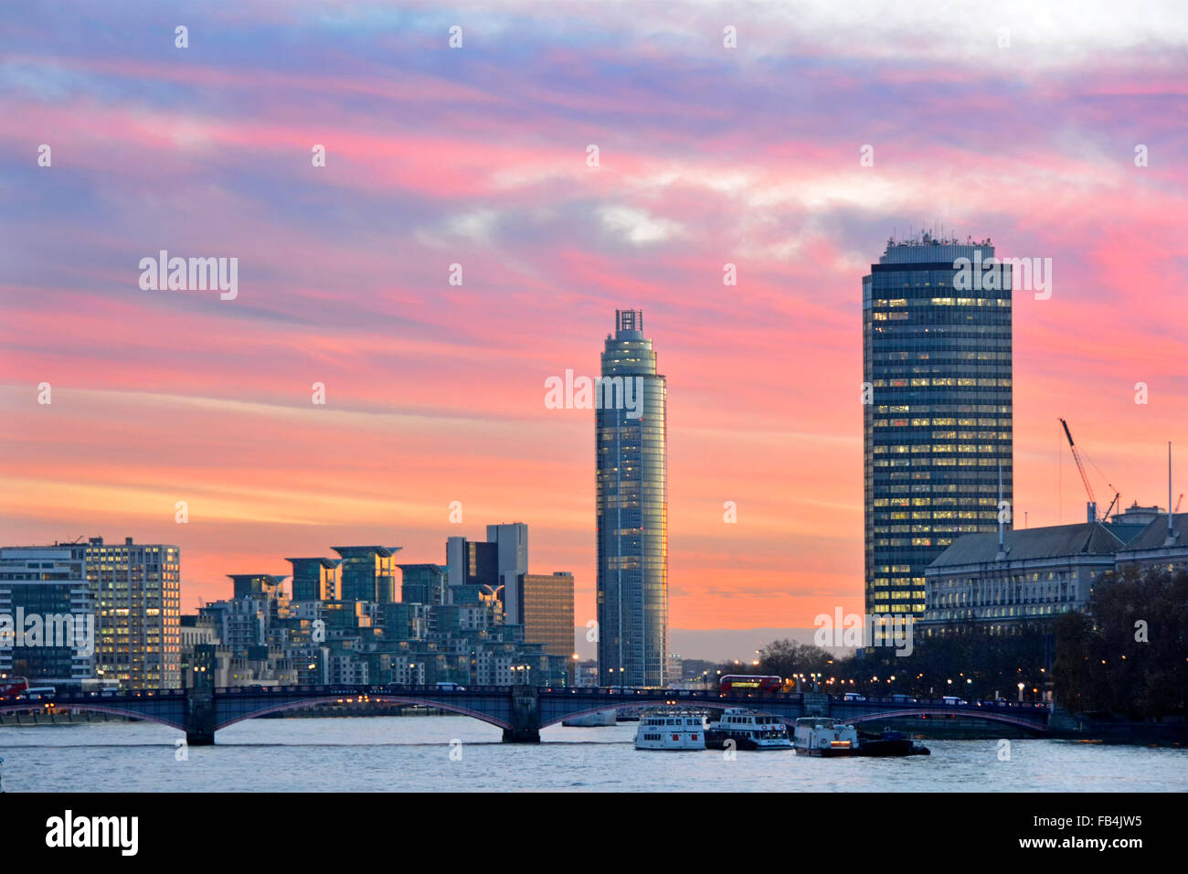 River Thames sunset looking towards Vauxhall Bridge from Westminster with St George Wharf Tower apartment building - Stock Image
