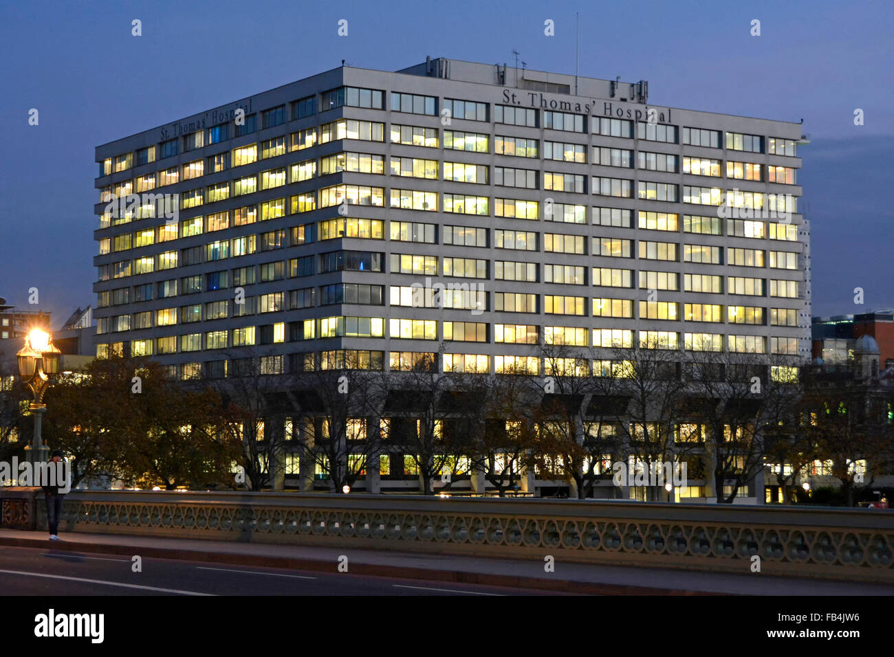 St Thomas Hospital London seen from Westminster Bridge at dusk England UK - Stock Image