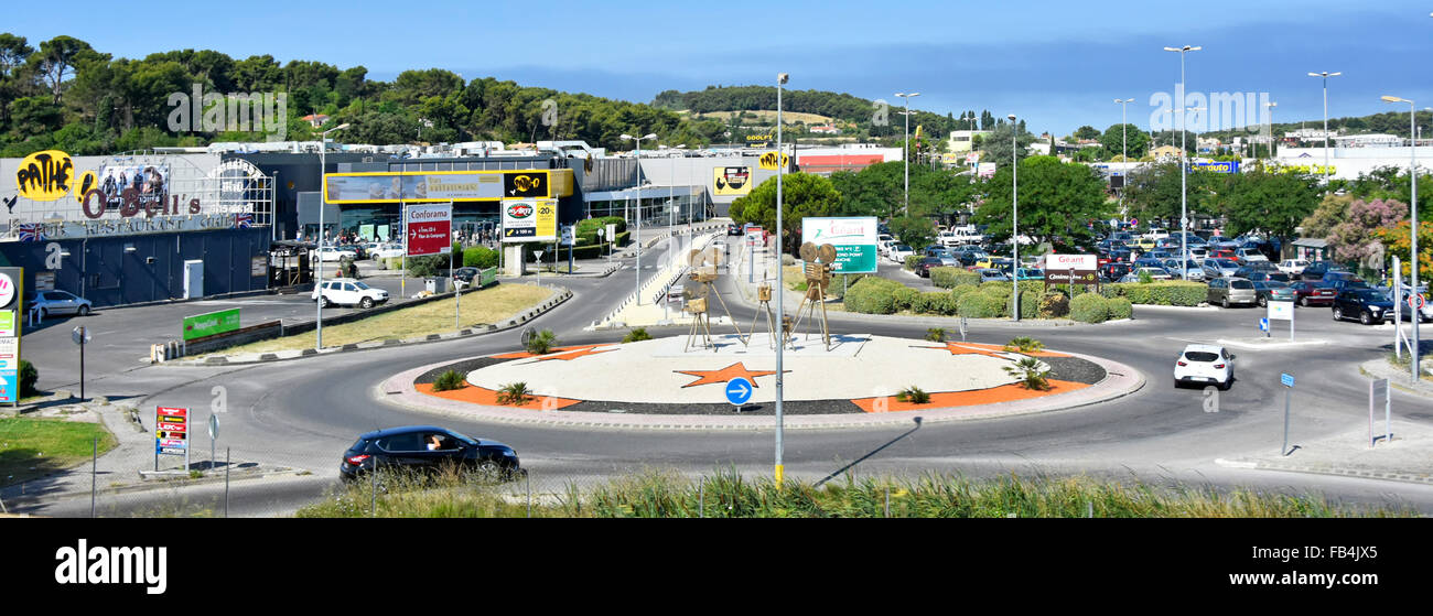 French retail park estate & roads near Marseilles including Cine film making sculptures on roundabout & - Stock Image