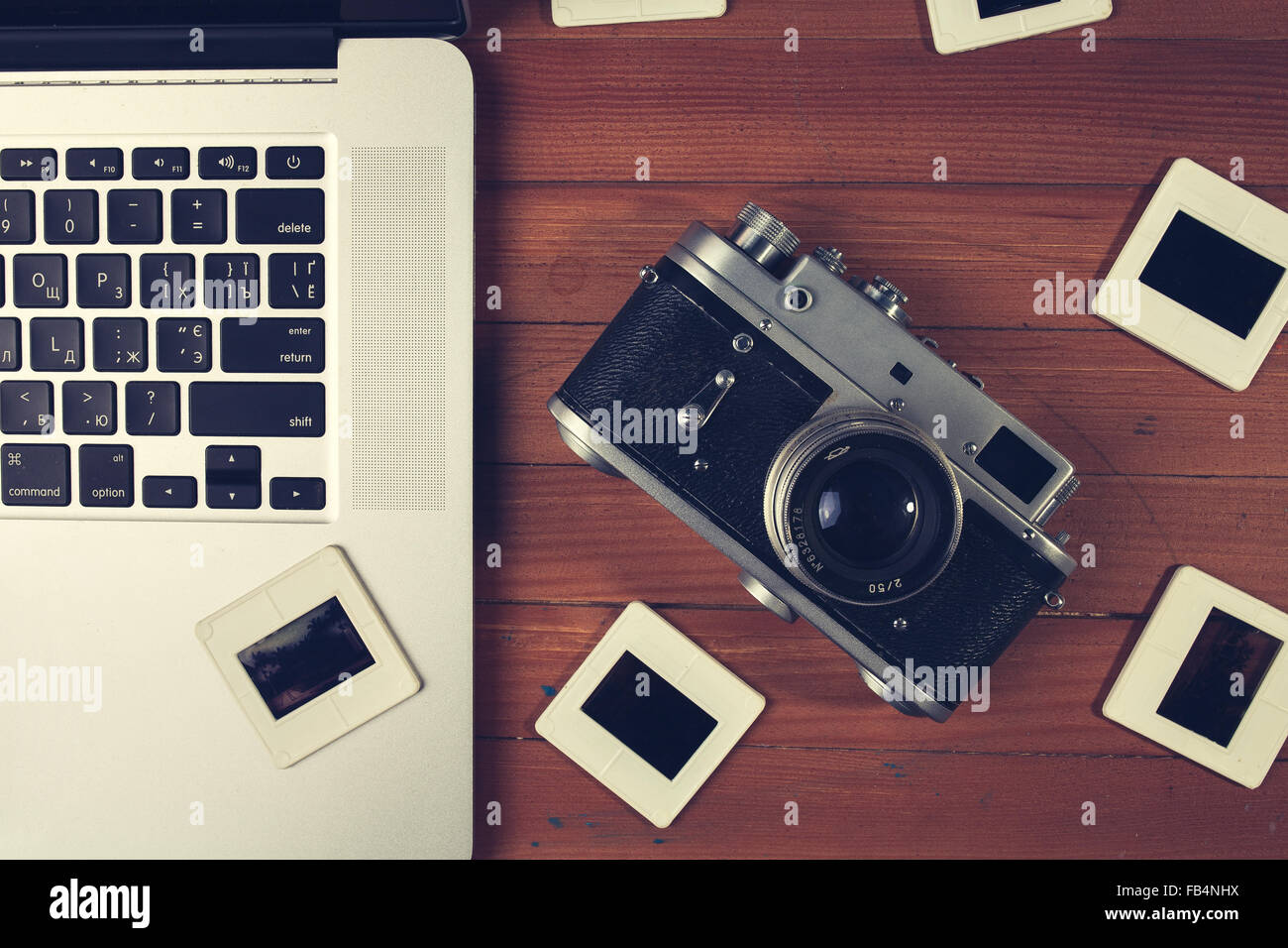 composition of old fashioned photo camera laptop and photo slides