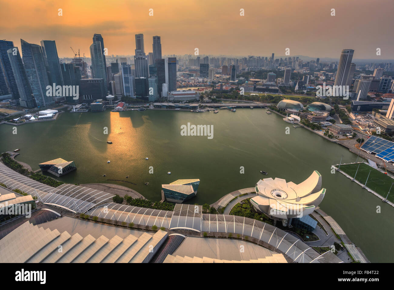 sunset at Singapore City Skyline view at Marina Bay - Stock Image