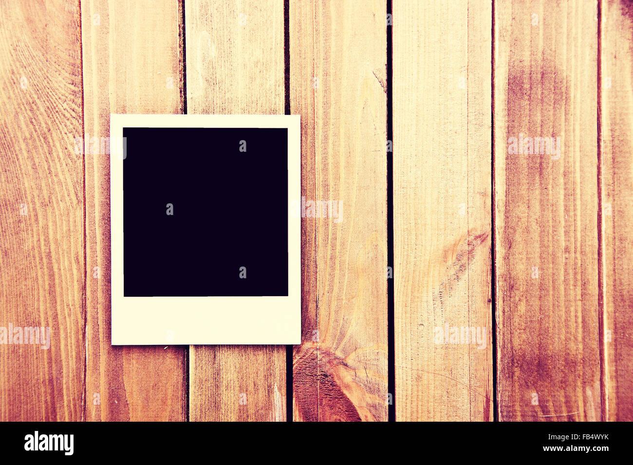 Instant blank polaroid photos frame on wooden background. Free copyspace. Vintage retro. - Stock Image